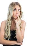 Uneasy gorgeous blonde in black dress posing