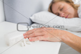 Blonde woman lying motionless after overdose of medication