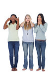 Young women acting out three wise monkeys