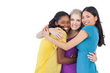 Diverse young women embracing each other