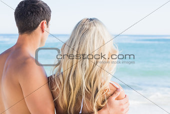 Rear view of couple looking out to sea