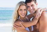 Beautiful couple hugging and smiling at camera