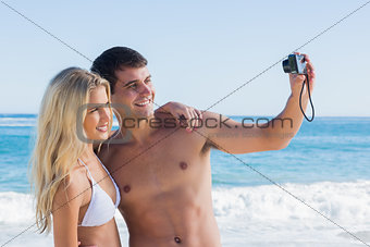 Man taking self portrait of him and girlfriend