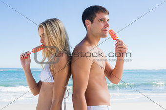 Happy young couple eating ice creams