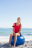 Fit blonde sitting on exercise ball