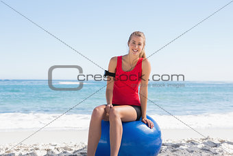 Fit young blonde sitting on exercise ball