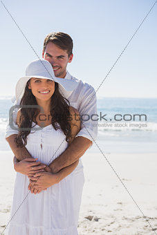 Affectionate couple smiling at the camera