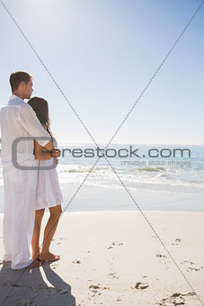 Attractive couple looking out at ocean