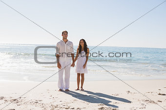 Beautiful couple holding hands and looking at camera