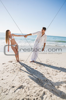 Happy couple holding hands and leaning to either side