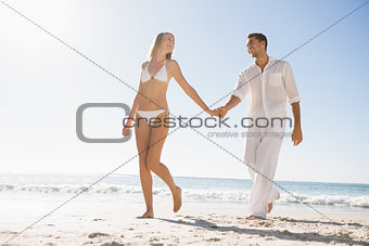 Pretty blonde walking away from man holding her hand