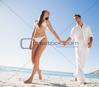 Beautiful blonde holding hands with happy boyfriend