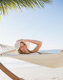 Smiling blonde relaxing on hammock