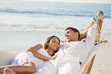 Peaceful couple relaxing on hammock