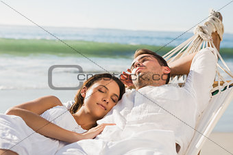 Peaceful couple napping in a hammock