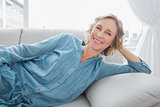 Cheerful woman relaxing on her couch