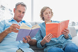 Relaxed couple reading books on the couch