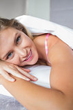 Beautiful blonde lying in her bed