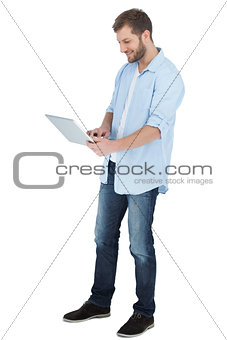 Casual man using his laptop