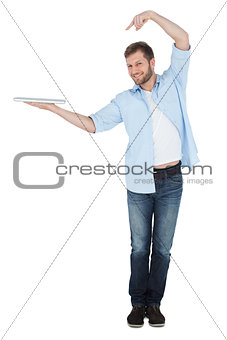 Happy model holding laptop on right hand with flair
