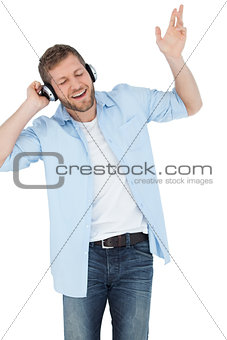 Cool trendy model listening to music and singing