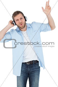 Trendy model listening to music and singing