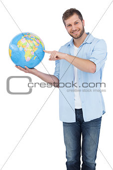 Charming model holding a globe