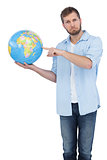 Charming model holding a globe on right hand