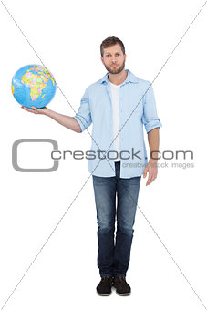 Charming young model holding a globe