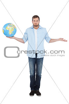 Charming model holding a globe and making faces
