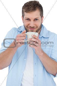 Casual model holding a mug