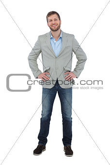 Stylish man smiling with hands on hips looking at camera
