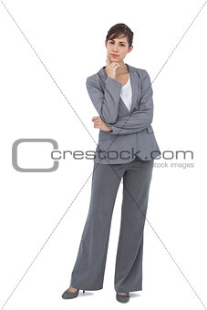Thoughtful young businesswoman looking at camera
