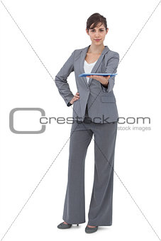 Attractive businesswoman holding tablet pc