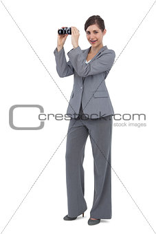 Businesswoman posing with binoculars