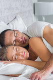 Cute couple sleeping and spooning in bed