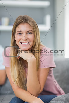 Happy woman sitting on couch