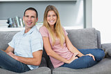 Relaxed couple sitting on the couch together