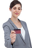 Confident businesswoman holding credit card