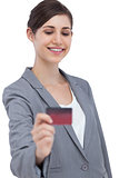 Smiling businesswoman with credit card