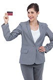 Smiling businesswoman with red credit card