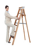 Businesswoman climbing career ladder