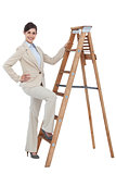 Cheerful businesswoman climbing the career ladder