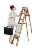Businesswoman climbing career ladder with briefcase