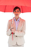 Young businesswoman with red umbrella