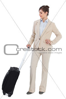 Confident businesswoman with suitcase