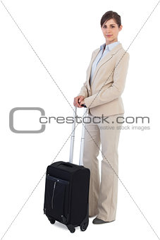 Businesswoman posing with suitcase