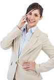 Cheerful businesswoman on the phone looking at camera