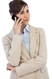 Pensive businesswoman on the phone