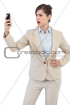 Angry businesswoman on the phone